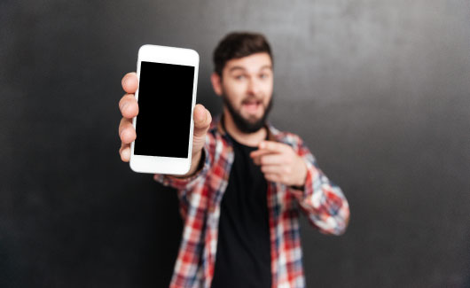 Man Holding Guard Assure Mobile Device with Protection Plan
